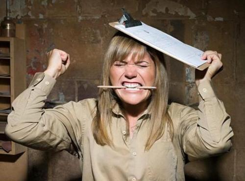 Angry woman biting a pencil