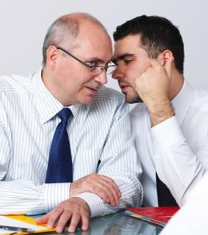 whispering men