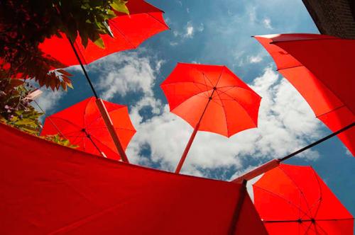red umbrellas against the sky